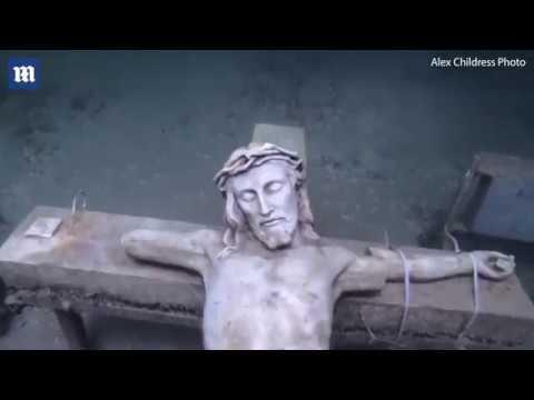 Stunning video of underwater crucifix in frozen Lake Michigan