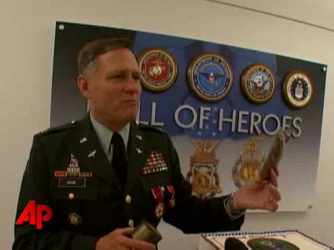 Raw Video: Army Colonel Eats 40-year-old Cake