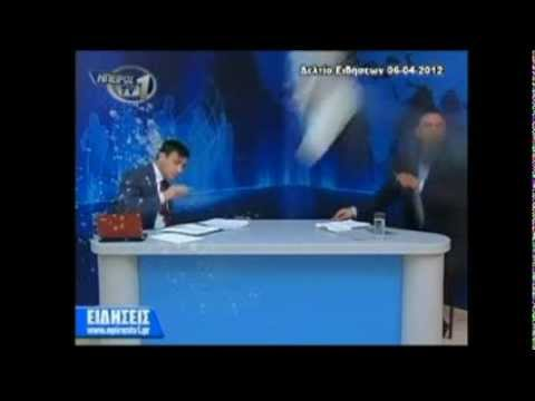 Greece Protesters Egg Newscaster on Live TV (Raw Video)