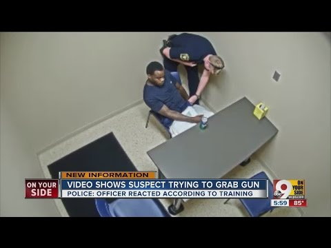 Murder suspect grabs for officer's gun