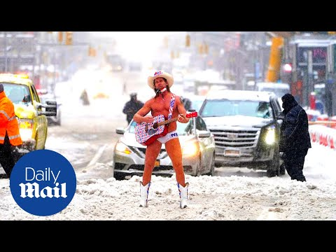 'Naked Cowboy' performs in Times Square after snow storm in New York