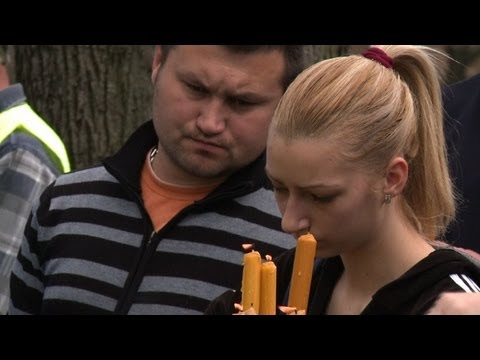 Serbia buries 13 victims of shooting spree
