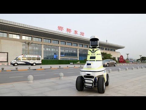 'Robot traffic police' put on duty in north China| CCTV English