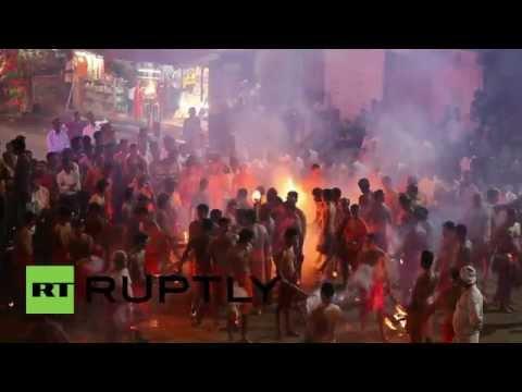 India: Men set each other alight to appease goddess Durga