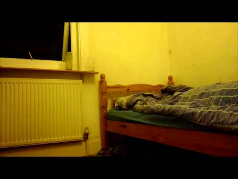 Man films ghostly manifestation hovering over bed while he s