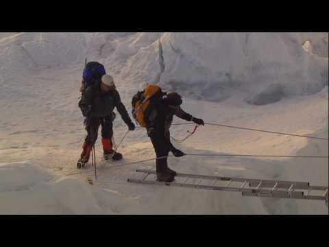 Erik crosses a ladder that spans a crevasse