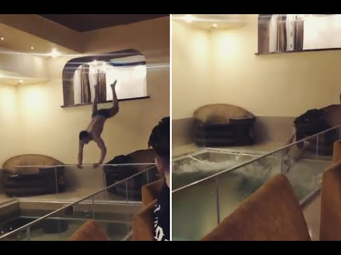 Birthday boy leaps head-first through glass panel into swimming pool | Video