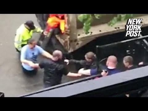Good Samaritans form human chain to help woman in labor through floodwaters | New York Post