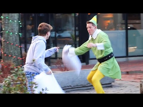 Firefighter Dressed as Elf Starts Random Pillow Fights to Spread Holiday Cheer