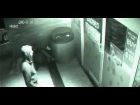'Time travelling ghost' in black hoodie walks straight THROUGH closed shop door in spooky footage