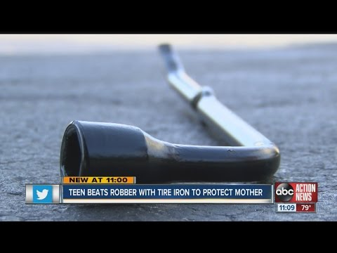 Teen hits armed robber with tire iron, body slams him in order to protect family
