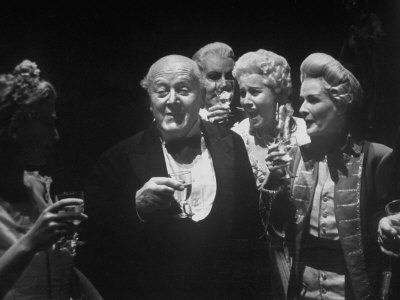 745336~John-Christie-Enjoying-Champagne-Party-Backstage-After-Performance-Of-Figaro-Glyndebourne-Festival-Posters.Jpg