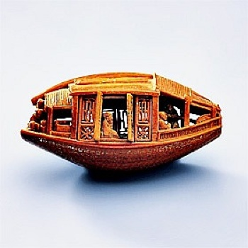 1.1257946946.Boat-Carved-From-An-Olive-Pit