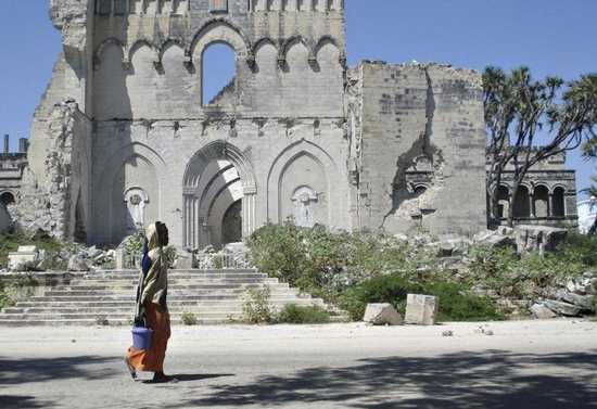 Somali Woman Walks Past A Church Destroyed By Fighting In Mogadishu January 6, 2008