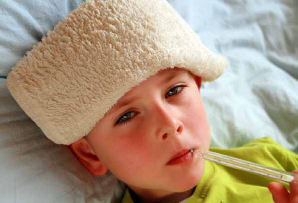 Getty Rf Photo Of Sick Boy With Thermometer