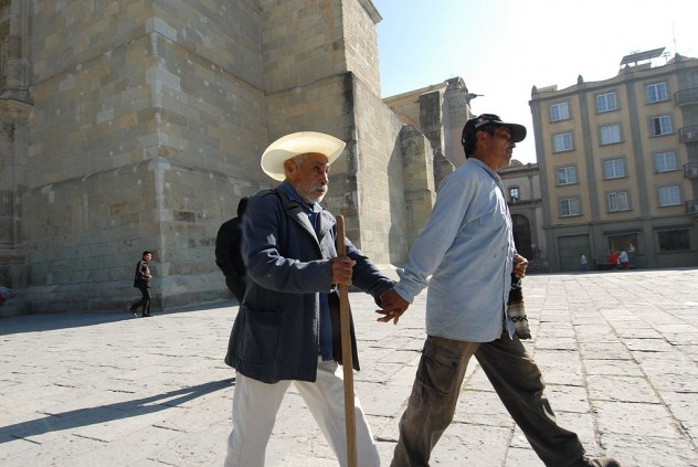 Assisting_blind_man_walking_mexico