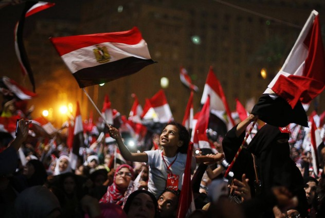 Protesters, who are against Egyptian President Mohamed Mursi, react in Tahrir Square in Cairo