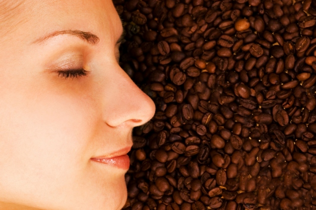Beautiful girl's face on over coffee bean background