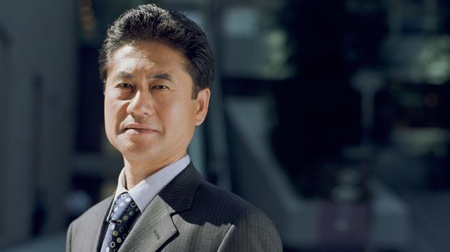 Neutral-Faced Asian Man