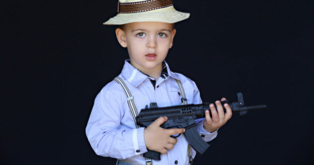 9-feature-toddler-with-gun-504903869