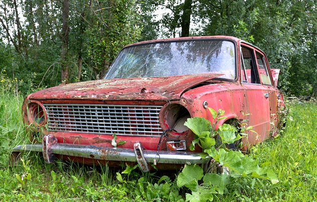 Abandoned old car in a meadow