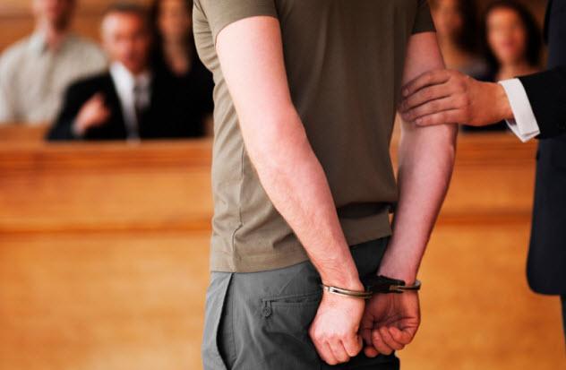 10-handcuffed-man_000024401181_Small
