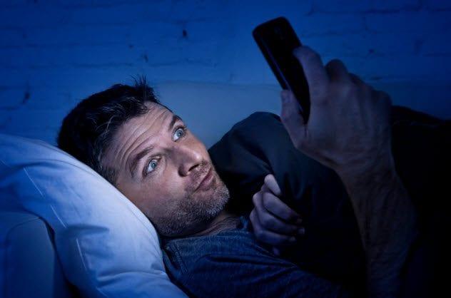 5a-man-watching-online-porn-498175998