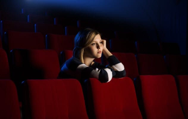 6a-unhappy-audience-member-at-empty-cinema-498855762